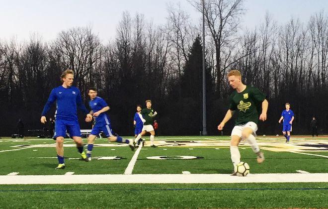 FC Buffalo's Sammy Wasson, with the ball, is defended by Daemen's Niklas Ringdahl Bohlin, far left. (Ben Tsujimoto/Buffalo News)