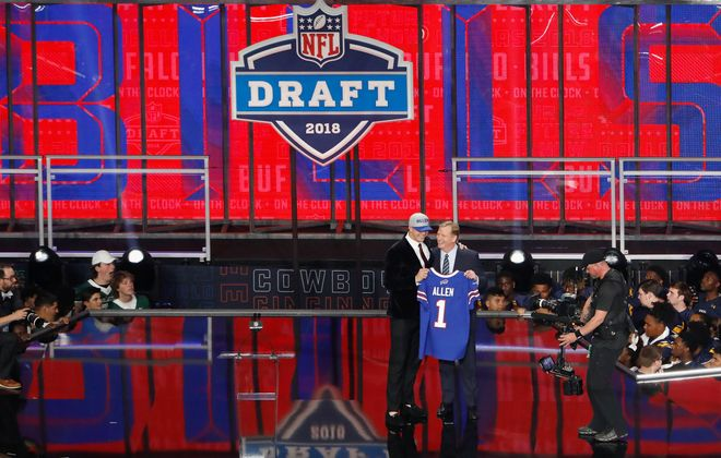 Josh Allen of Wyoming poses with NFL Commissioner Roger Goodell after being picked No. 7 overall by the Buffalo Bills (Getty Images)