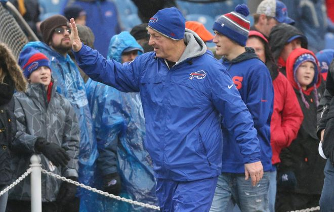 Jim Kelly waves to fans at a Bills game. (James P. McCoy/News file photo)