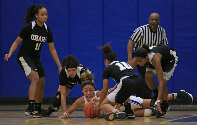 The Cardinal O'Hara girls basketball team fought off all local competition while on the way to finishing atop The Buffalo News' large schools poll for the third straight year. (Harry Scull Jr./Buffalo News)