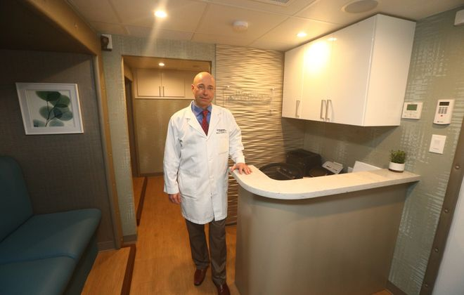 """""""The cure rate of Stage I breast cancer is almost 100 percent. If it goes to a lymph node, it dramatically goes down. That's the whole premise of screening."""" -Dr. Markus Holzhauer, director of mobile mammography at Windsong Radiology Group, pictured inside the group's new mobile mammography van. (John Hickey/Buffalo News)"""