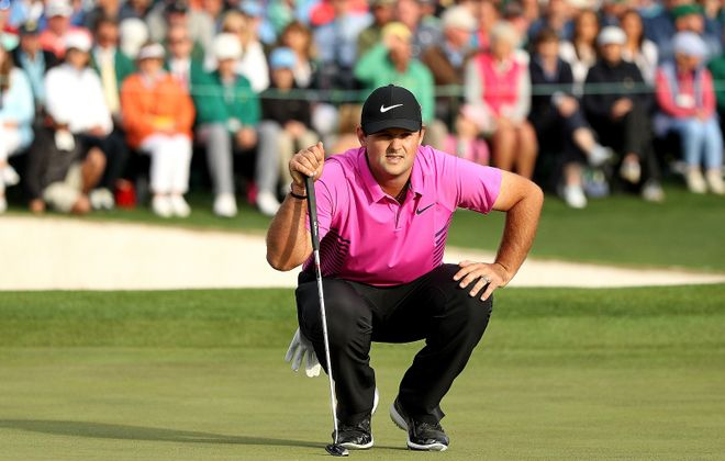 Masters champion Patrick Reed, pictured eyeing a putt on the 18th hole, won his first major on Sunday in Augusta, Ga. (Patrick Smith/Getty Images)