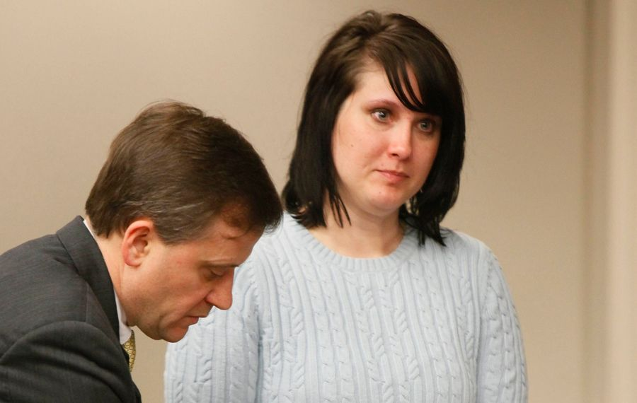 Cara L. Dickey, in this 2009 file photo, as she pleaded guilty to rape charges. At left is her attorney, Dan Chiacchia. (Derek Gee/News file photo)