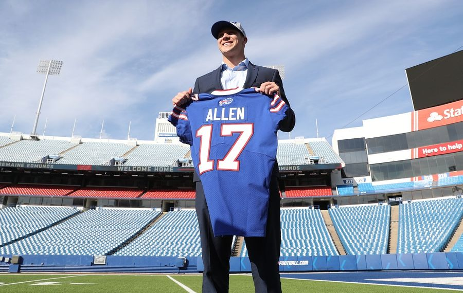 Buffalo Bills first-round pick, quarterback Josh Allen, poses with his No. 17 jersey at New Era Field. (James P. McCoy/Buffalo News)