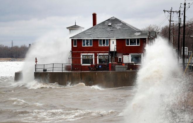 Wind and waves crash into the shoreline near Hoak's restaurant and Route 5 in Hamburg under normal conditions. Federal officials said higher than average water levels could exacerbate shoreline impacts and erosion this fall. (Mark Mulville/News file photo)