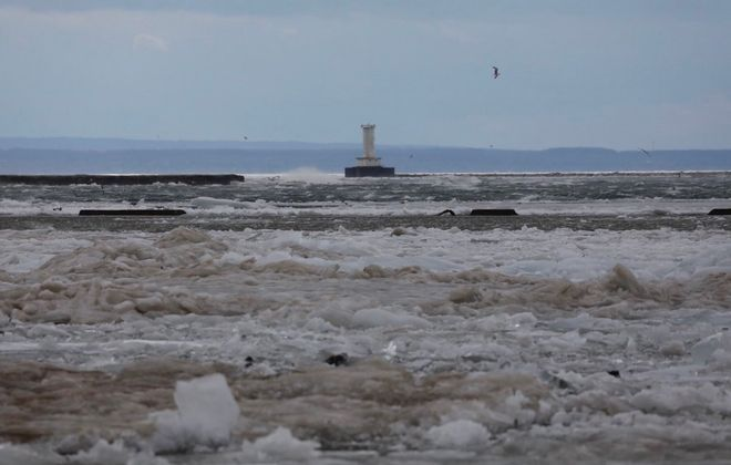 "The New York Power Authority said ""the ice boom is designed to submerge during high wind and high water events, allowing ice to overtop the boom."" (Derek Gee/Buffalo News)"