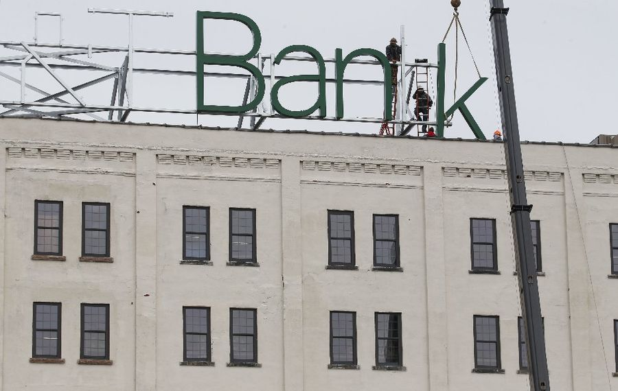 M&T Bank is putting a huge sign atop the Larkin Center of Commerce. (Derek Gee/Buffalo News)