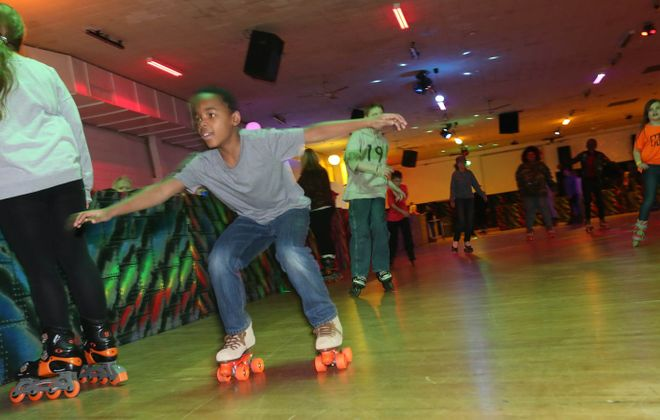 On a recent night, the Rainbow Rink was rocking -- and rolling. (Sharon Cantillon/Buffalo News)