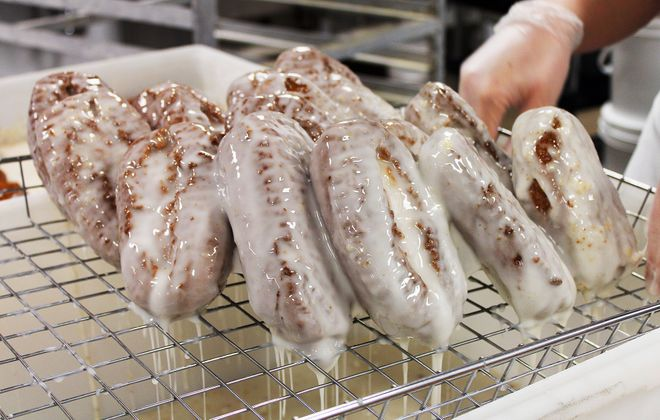 Paula's famous peanut stick gets a dunk in glaze — and a few minutes to drip — before getting tossed in its crushed peanut coating. (Brennan Carey)