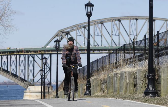 The Buffalo Ride for Silence is a part of the international event that mourns the deaths of cyclists. Pictured is Justin Leis riding near the Peace Bridge. (Derek Gee/News file photo)