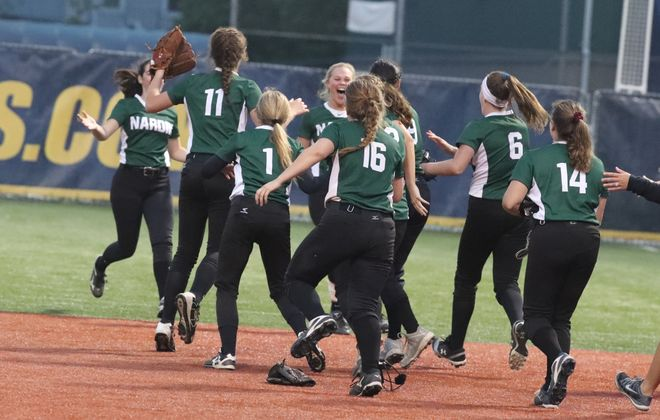 Nardin celebrates beating St Mary's, 1-0, in 10 innings in the  Monsignor Martin softball final at Canisius College. (James P. McCoy/Buffalo News)