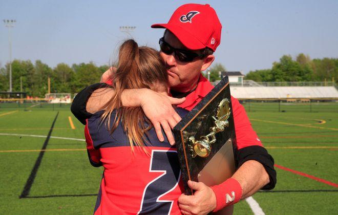 Iroquois assistant coach Matt Haberl hugs his daughter Kennedy after defeating Lewiston-Porter. (Harry Scull Jr./Buffalo News)