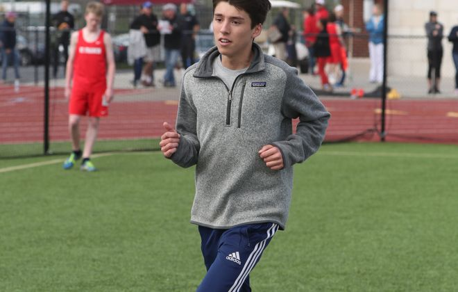Canisius' Lucas Beyer almost became the first distance runner since 2000 to win the 800-meter, 1,600-meter and 3,200-meter races at the All-Catholic Championships.  A violation in the 1,600 led to his win in the event being turned into a DQ. (James P. McCoy/Buffalo News)