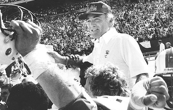 Buffalo Bills head coach Chuck Knox is carried off the field after the Bills defeated the Miami Dolphins ending their 20-game losing streak against the Dolphins. Taken on Sept. 9, 1980. (News file photo)