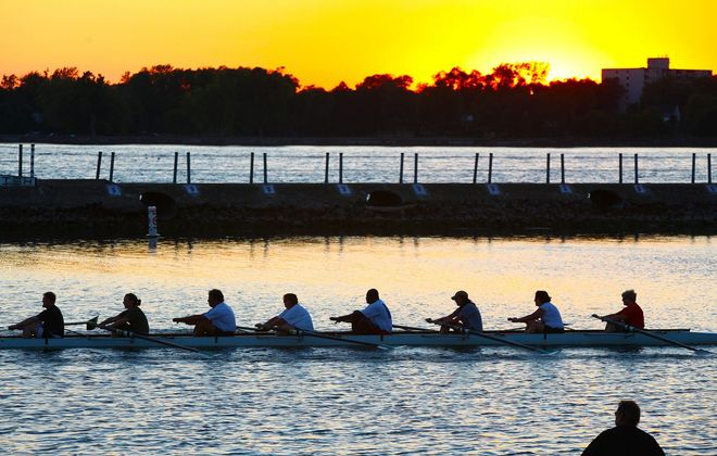 A rowing team races by the West Side Rowing Club at the foot of Porter Avenue. (Buffalo News file photo)
