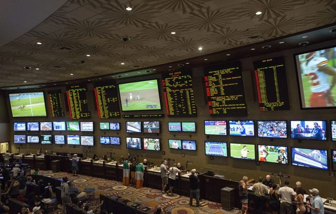 People place bets on sports at the MGM Grand Race & Sports Book in Las Vegas. (Bridget Bennett/The New York Times)