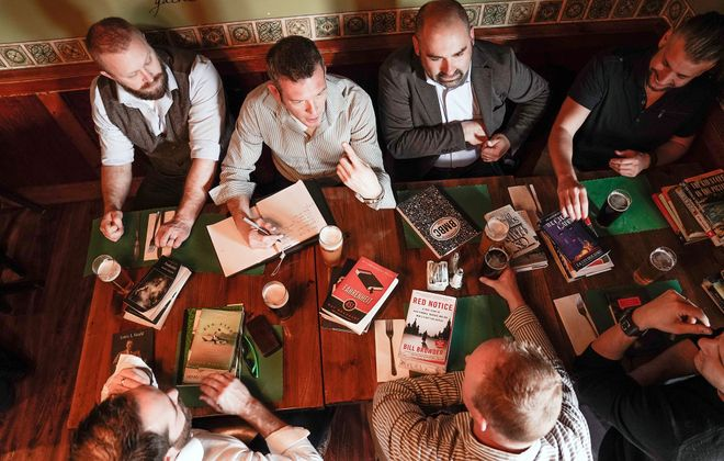 "Meeting of the minds: The Buffalo Men's Book Club discusses their latest read, ""Fahrenheit 451,"" over beers at The Blackthorn in South Buffalo.  (Dave Jarosz)"