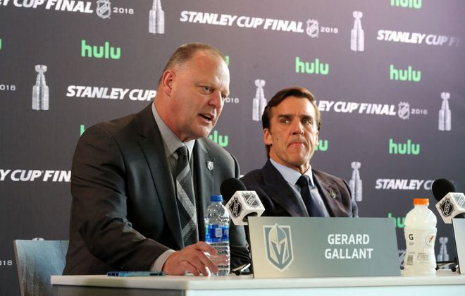 Vegas coach Gerard Gallant answers a question as General Manager George McPhee looks on Sunday in T-Mobile Arena (Getty Images).