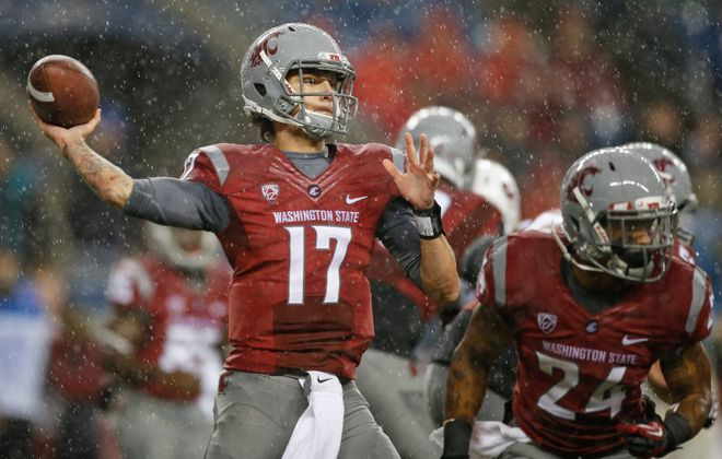 Quarterback Austin Apodaca of the Washington State Cougars passes against the Stanford Cardinal on Sept. 28, 2013, at CenturyLink Field in Seattle. (Otto Greule Jr./Getty Images)
