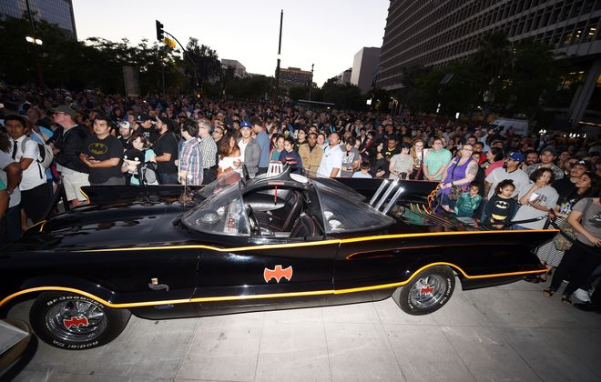 Fans gather around a Batmobile in 2017 in Los Angeles. (ROBYN BECK/AFP/Getty Images)