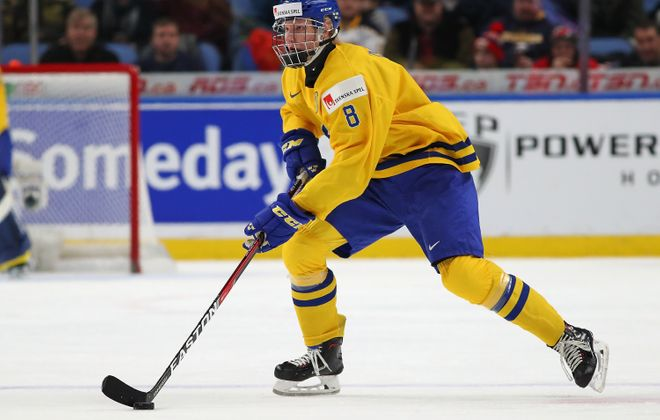Because Rasmus Dahlin knows the puck is glued to his stick, he can make plays at full speed. (Getty Images)