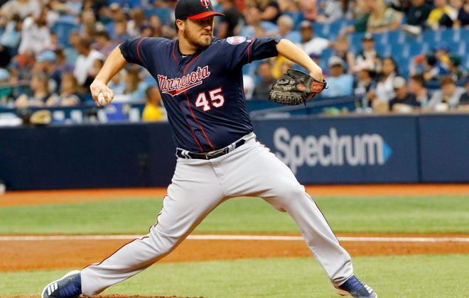 """""""With all the advanced data we have now, guys are smarter about pitching and they're also throwing the ball harder than ever,"""" Twins pitcher Phil Hughes told the Minneapolis Star-Tribune. (Joseph Garnett Jr./Getty Images)"""