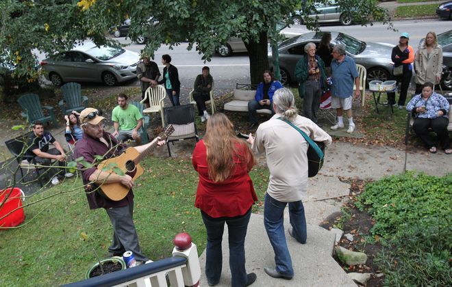 Scenes from the Elmwood Village Association's first Porchfest, back in 2013. Here, the Healing Committee plays in front of a crowd on Richmond Avenue. (Sharon Cantillon/Buffalo News)