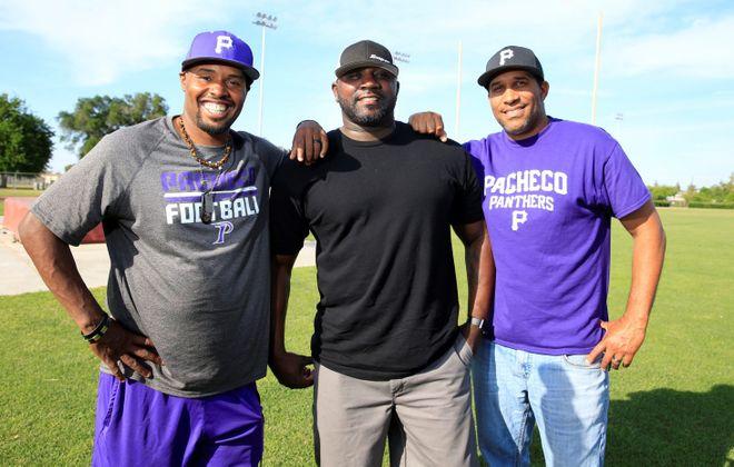 Offensive coordinator Tyrell Jenkins, quarterback coach Michael Tate and defensive coordinator Chauncey Lee. (Harry Scull Jr./Buffalo News)