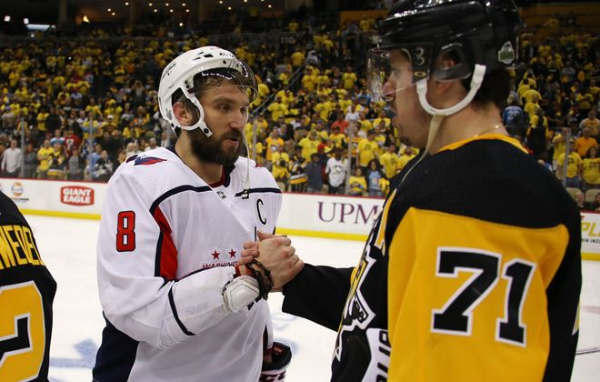 Alex Ovechkin, left, finally got handshakes from the Penguins for the first time in his career as Evgeni Malkin congratulated him for the Game 6 victory Monday night in Pittsburgh. (Getty Images)