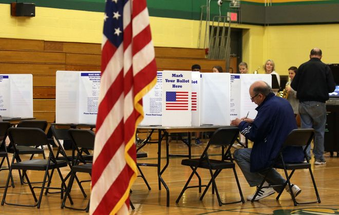 Voters vote on School Budget and School Board members in the suburbs at Williamsville North High School, in Williamsville, N.Y., on Tuesday May 17, 2016.   (John Hickey/Buffalo News)