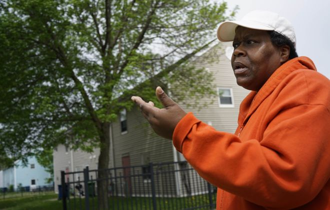 Longtime Langfield Homes resident Cynthia Moore outside her apartment on May 23, 2018. Langfield Homes scored a 46 out of 100 in a recent inspection by the U.S. Department of Housing and Urban Development. It was the lowest score given to any public housing complex in Erie County in the past five years. (Derek Gee/Buffalo News)