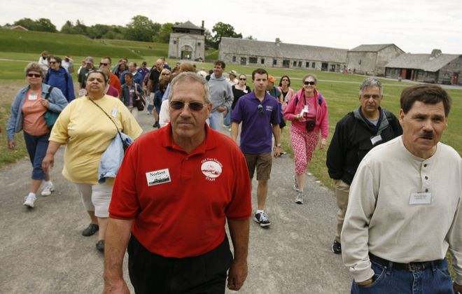 The Rev. Norbert Orsolits, at center in red shirt, volunteering at Old Fort Niagara in Youngstown in 2009. The Buffalo Diocese is accused by Michael Tatu, who filed a Child Victims Act lawsuit, of covering up a complaint in 1968 that Orsolits molested Tatu. Orsolits told The Buffalo News in 2018 that he had sexual contact with probably dozens of teen boys while serving as a priest. (Buffalo News file photo)