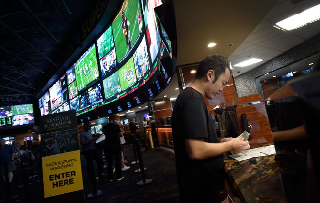 A customer makes a sports bet at the Race & Sports SuperBook in Las Vegas. (Washington Post file photo)