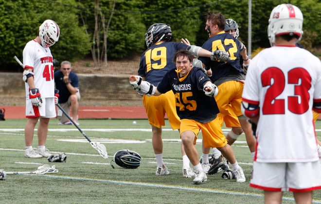 Mathieu Boissonneault and Canisius celebrate after the Golden Griffins' overtime victory against Detroit in the Metro Atlantic Athletic Conference championship game on Saturday. (Photo courtesy of Stockton Photos)