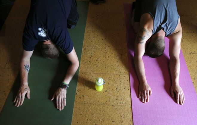 """Christopher """"Topher"""" Kessler, left, and Randolph Fix are among those who've added yoga as part of their addictions recovery treatment at Turning Point House, a Cazenovia Recovery Systems residential program in Eden. (Robert Kirkham/Buffalo News)"""