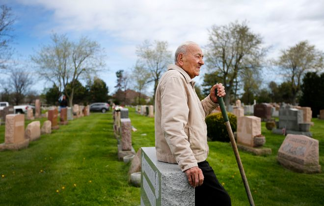 Arthur Herdzik rests while taking care of the family graves at St Stanislaus Cemetery in Cheektowaga Friday, May 11, 2018.   (Mark Mulville/Buffalo News)