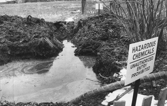 Chemicals from the Love Canal hazardous waste site were found in stormwater off Read Avenue near the 99th Street School in Niagara Falls on April 15, 1979. Officials posted signs to keep children and passersby out of the hazard zone. (News file photo)