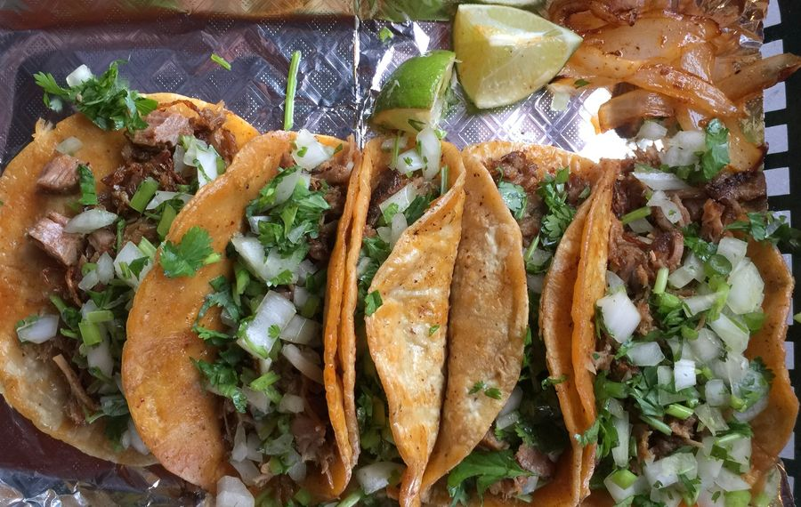 At the taco trailer next to Medina's Monte Alban grocery store, legit tacos, fillings griddled before serving, come five for $8. (Andrew Galarneau/Buffalo News)