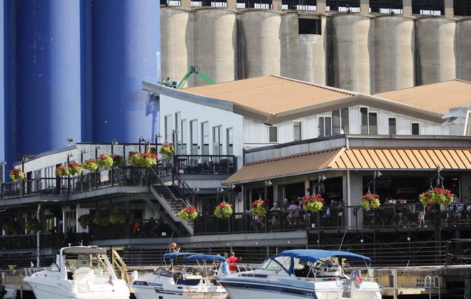 The owners of Buffalo RiverWorks purchased the GLF grain silo complex next door, shown here behind the blue six-pack. (Buffalo RiverWorks)