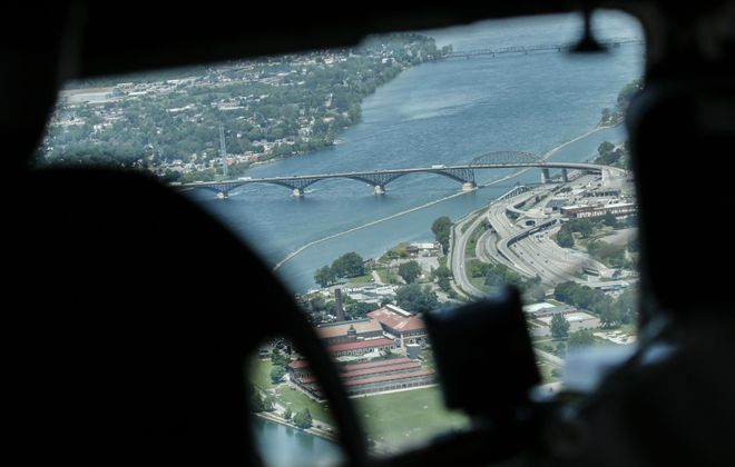 "The view of the Peace Bridge through the cockpit of the C-47 ""Whiskey Seven"" during the WWII Heritage Flight over WNY to draw attention to the Thunder of Niagara Air Show in Niagara Falls this weekend, Thursday, June 7, 2018. (Derek Gee/Buffalo News)"
