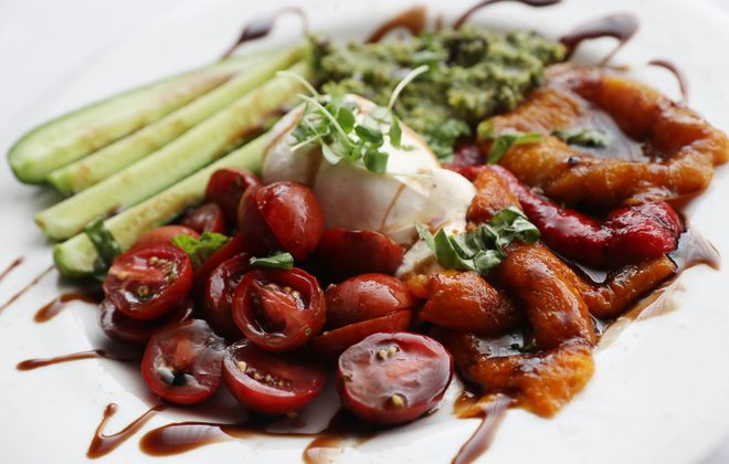 Sinatra's burrata is made with fresh Italian buffalo milk cheese, roasted peppers, pesto cucumbers and grape tomatoes. (Sharon Cantillon/News file photo)