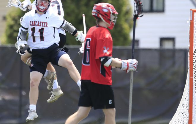 Lancaster's Alex Reimer celebrates his goal with Ben Napleralski against Penfield during first half action of the Class A Far West Regional title at Robert E. Rich All High Stadium on Saturday June 2, 2018. (Harry Scull Jr./ Buffalo News)