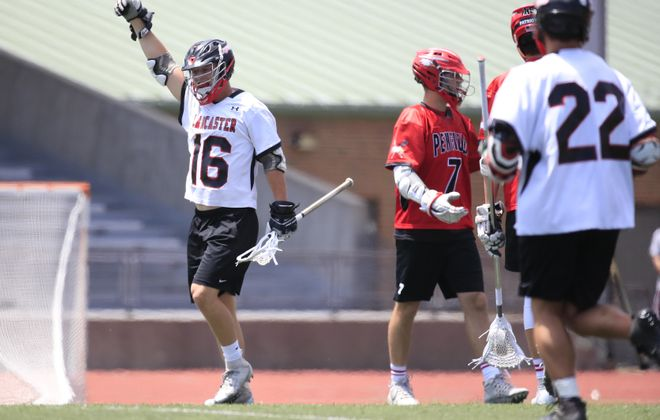 Lancaster's Brett Beetow celebrates a goal against Penfield during last weekend's Far West Regional Class A contest at All High Stadium. (Harry Scull Jr./ Buffalo News)