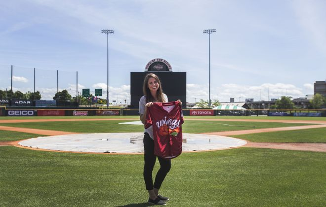 Michele Lange, the Bisons' graphic designer, shows her newly designed uniform for the conversion of the Buffalo Bisons to the Buffalo Wings for a series against the Rochester Plates at Coca-Cola Field. (Shuran Huang/Buffalo News)
