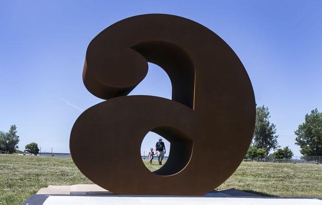 "Workers install Robert Indiana's 10 eight-foot tall sculptures of numbers ""NUMBERS ONE through ZERO"" at Wilkeson Pointe. Robert Lay and his granddaughter Annalise Lay walk along the riverside and enjoy the sculptures. (Shuran Huang/Buffalo News)"