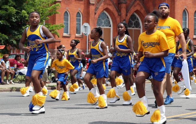 The Juneteenth parade travels to Martin Luther King Jr. Park. (James P. McCoy/Buffalo News)