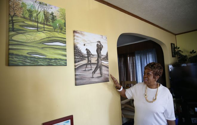 Barbara Dixon believes her son, Valentino, is going to be exonerated soon. She's photographed at her home in Buffalo on Friday, June 15, 2018, talking about her son's artwork from prison. (Sharon Cantillon/Buffalo News)