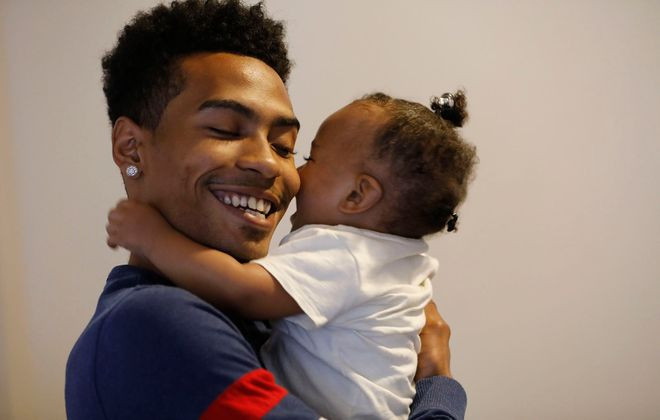 Jaelin Grey was accepted into the welding program at the Northland Workforce Training Center. He plays with his 17-month-old daughter Calia on June 6. (Derek Gee/Buffalo News)