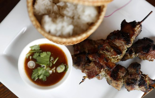 Moo ping with sticky rice at Rin Thai Bistro. (Mark Mulville/Buffalo News)