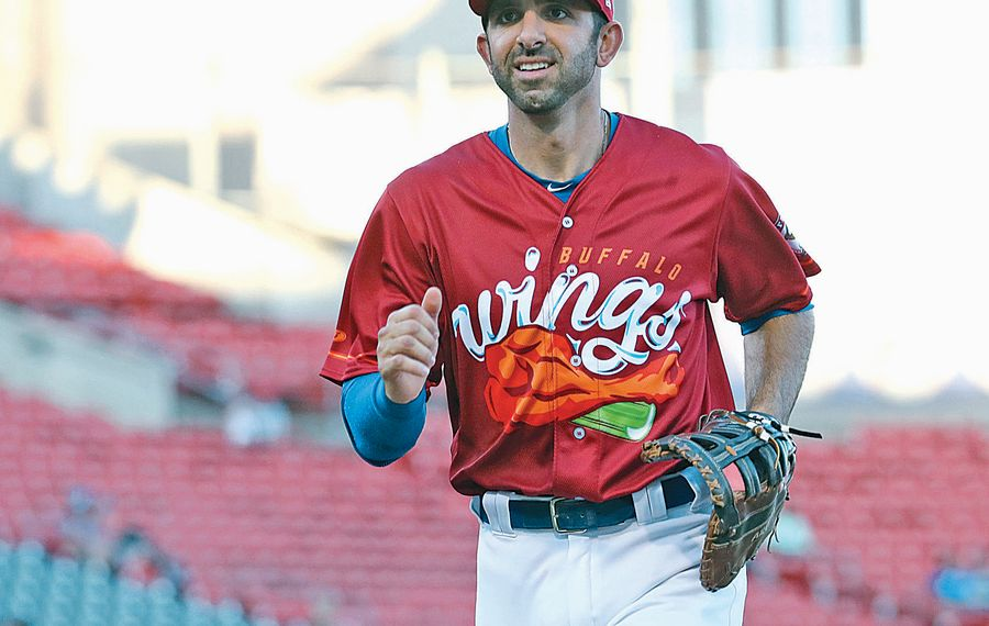 "Bisons first baseman Jason Leblebijian comes off the field after a good defensive inning. The Bisons are changing their name to the  ""Wings"" through their Sunday series at home. (Sharon Cantillon/Buffalo News)"